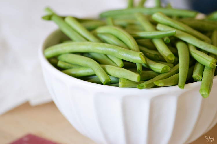 Wonder how to cook fresh green beans? Instead of roasting or steaming them, give sauteed green beans with a bacon a try. Loaded with flavor, your family will be saying yes to seconds with this tasty vegetable side dish! Everything is better with a little bacon, right?