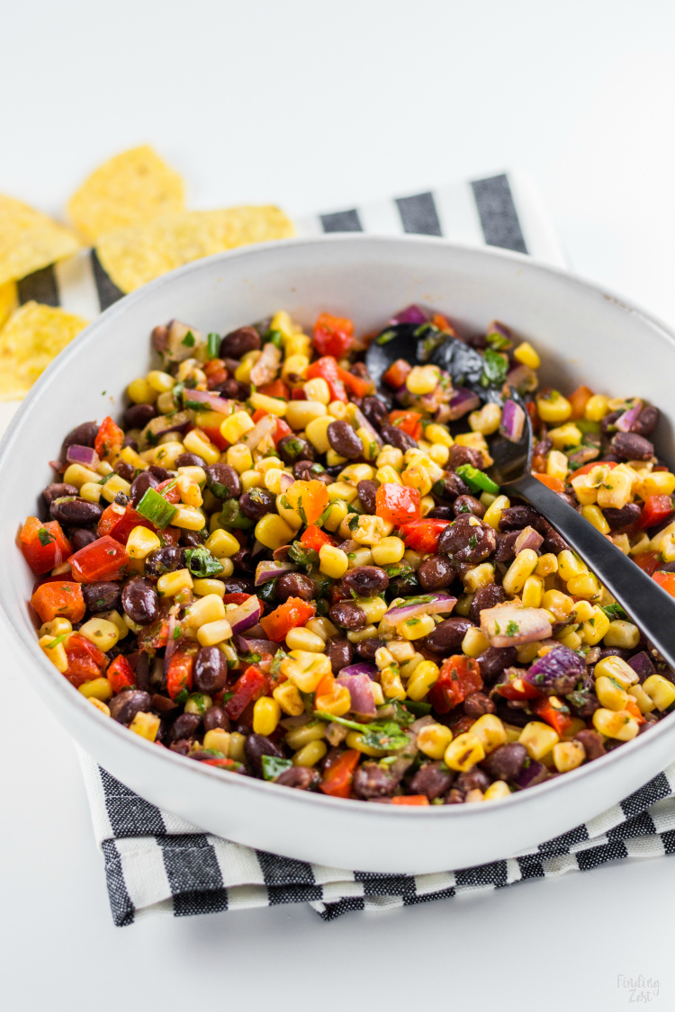 This homemade Black Bean Corn Salsa is sure to be a hit with any crowd! Kick up the flavor to your dinner recipes by serving it as a side dish or as topping to fish, chicken or your favorite Mexican dishes. It also makes for an easy appetizer when served with tortilla chips that everyone will love.