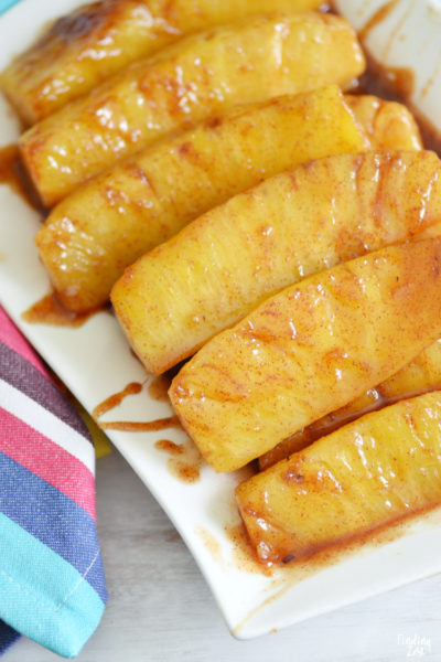 Try this cinnamon fried pineapple with brown sugar as a delicious side dish or dessert idea! This sauteed pineapple recipe can be made right on your stove in under 10 minutes and tastes great served with ice cream as dessert or as a side dish with your favorite Asian cuisine for lunch or dinner. Your pineapple doesn't even need to be ripe for this recipe.
