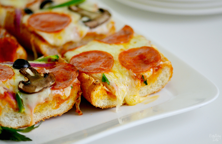 Whip up a delicious and easy weeknight dinner in under 20 minutes with this french bread pizza recipe. Loaded with your favorite pizza toppings including whole milk mozzarella cheese and garlic butter, the flavor is out of this world. Switch up toppings for variety and watch your family devour this pizza bread!