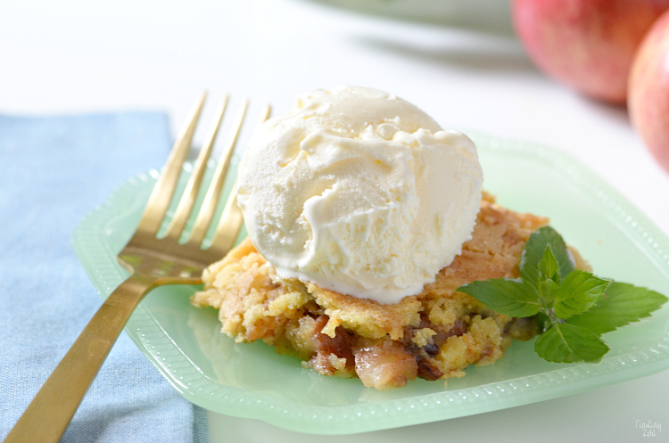 This apple dump cake is a deliciously easy recipe which features fresh apples and a yellow cake mix, no mixer required! The whole family will love this fall dessert served warm with a scoop of vanilla ice cream and you will love how quick this dump cake recipe is to make!