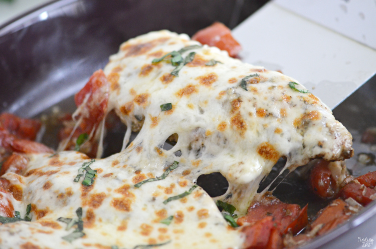 This baked caprese chicken recipe is an easy weeknight meal with melted mozzarella that no one can resist! All you need is 10 minutes to get this smothered chicken with tomatoes in the oven. Serve over pasta for a simple meal solution.
