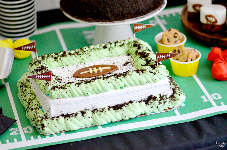 Satisfy everyone's sweet tooth at your next football party with this dessert table filled with scrumptious treats. You won't believe how easy it is to transform an ice cream cake into a football themed dessert that will wow your crowd. Plus, get other fun football party ideas for your tailgating at home celebration!