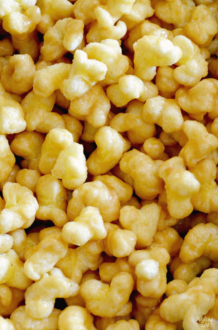 You'll love this caramel puff corn recipe, a tasty alternative to traditional caramel corn. Using bagged puff corn, this easy snack is baked for an awesome crunch. Works great for every day snacking, parties and game day! The hardest part will be keeping your hands off!