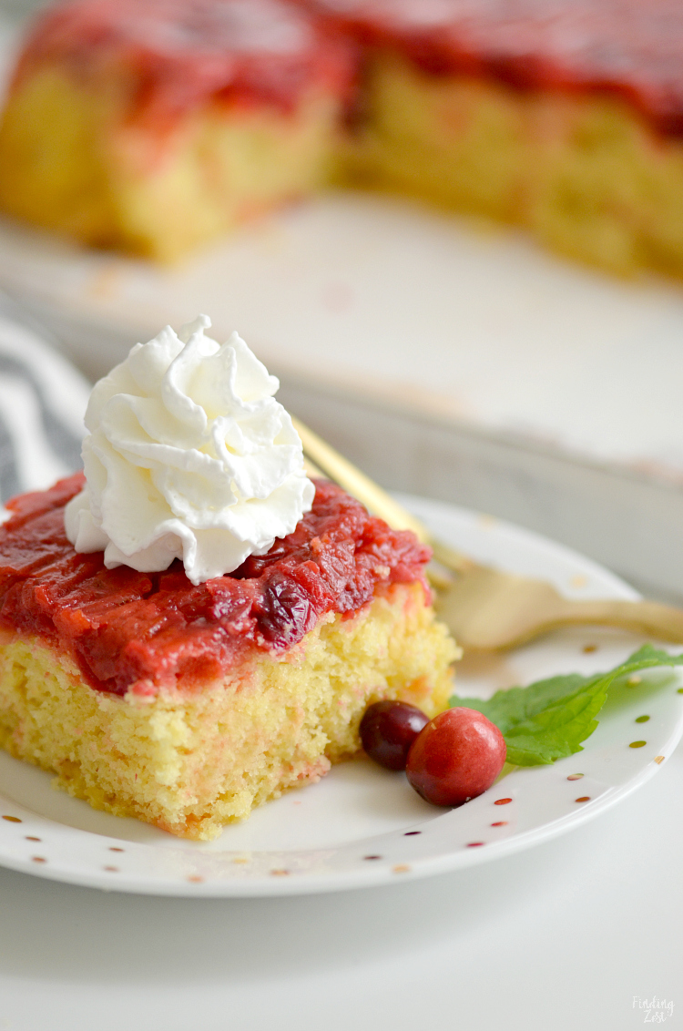 This easy Cranberry Upside Down Cake is the perfect blend of sweet and tart and features a soft and fluffy cake with pudding added. Guests won't be able to resist this cranberry cake that uses fresh cranberries and orange zest. Forget frosting and serve for Thanksgiving or Christmas dessert with whipped cream!