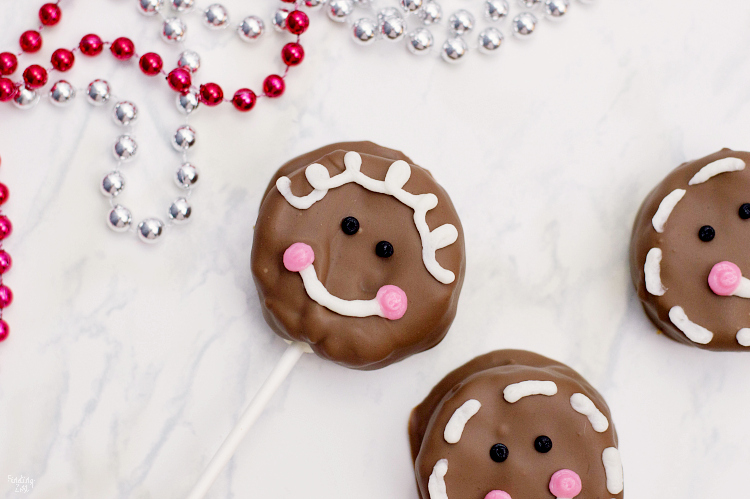These gingerbread cake pops are sure to bring smiles this holiday season! Made from homemade gingerbread cake, these cake pops feature a sweet gingerbread man face that is as fun as it is delicious! This recipe makes a great Christmas dessert for all ages.