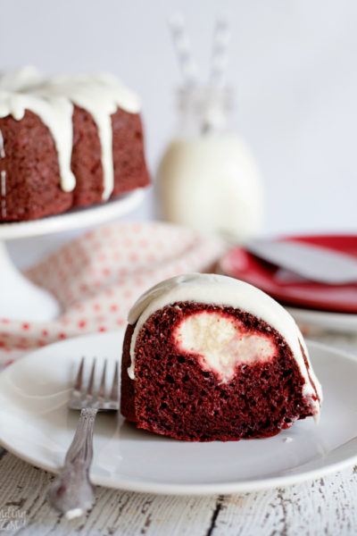 Your family won't be able to resist this red velvet bundt cake with cream cheese filling. Wow guests with this beautiful red and white cake that is easy to make and absolutely delicious. Make it for Christmas dessert or a special Valentine's Day sweet treat!