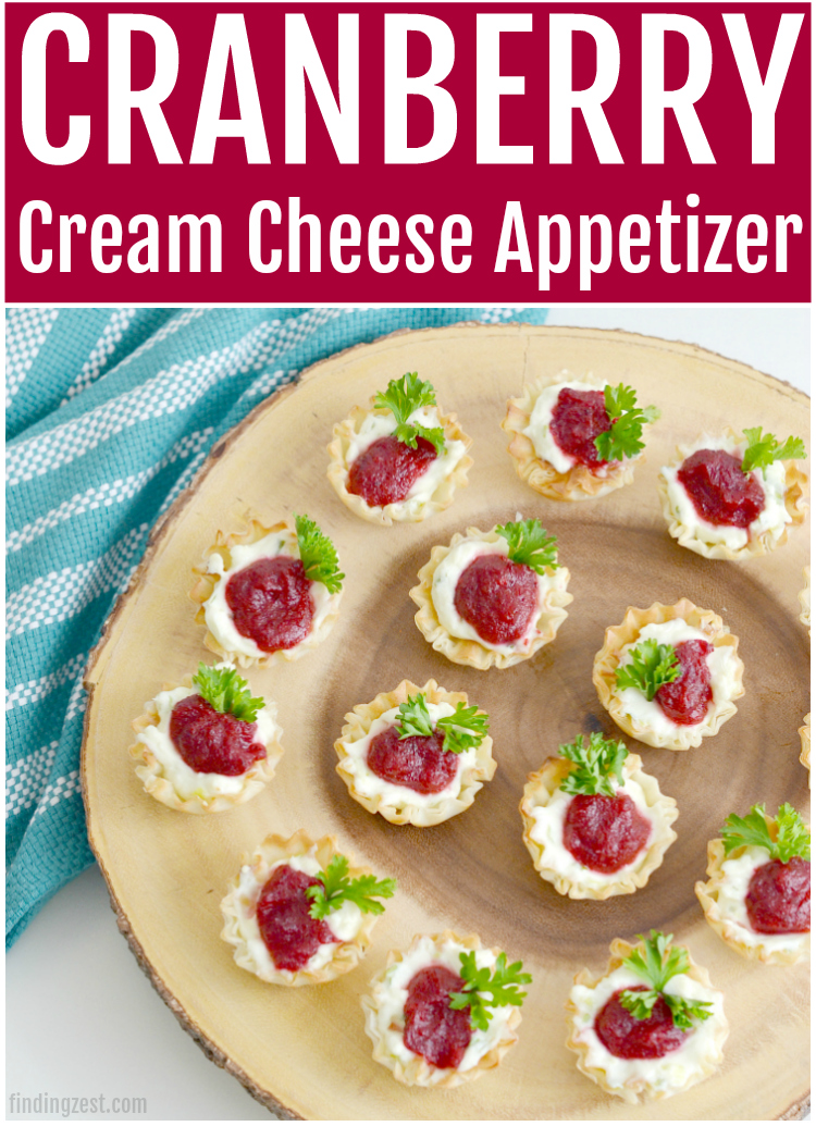 This cranberry cream cheese appetizer is an easy Christmas party food idea you won't be able to resist! These flavorful little cups are an easy holiday finger food that everyone can enjoy. Serve this cream cheese phyllo cup appetizer at your next holiday party!