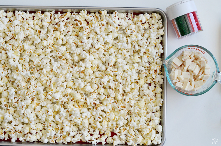 This white chocolate peppermint popcorn is a no bake holiday snack that kids will love to help make in celebration of The Berenstain Bears and the Joy of Giving children's book! This tasty popcorn treat is perfect for gift giving and only requires three ingredients.