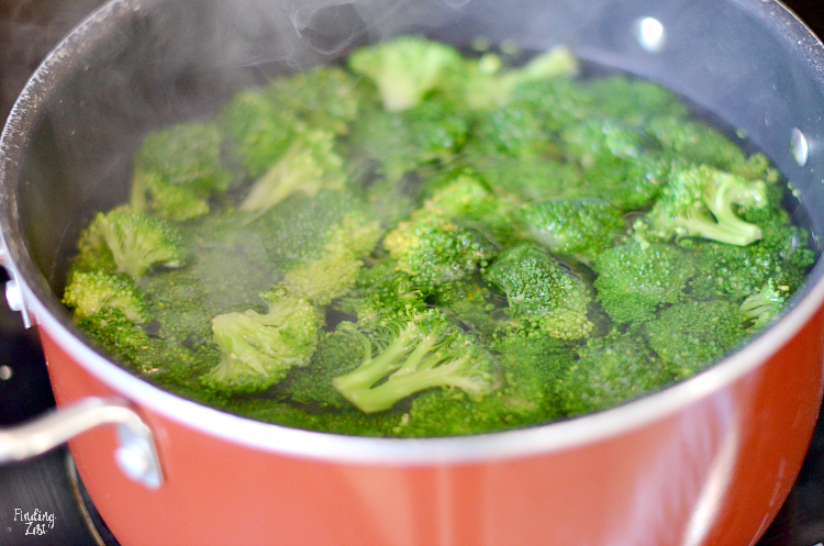 Blanching broccoli in a pot.