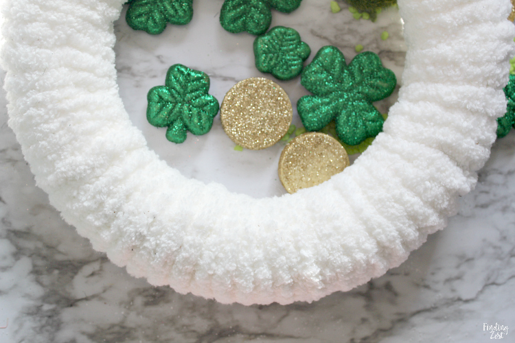 white yarn wreath and st patrick's day decorations