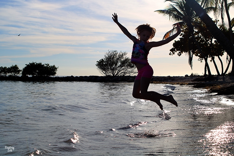 Girl jumping at Smathers Beach Key West Florida