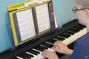 Playing piano with music from Because by Mo Willems and Illustrated by Amber Ren