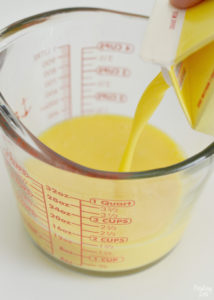 Adding Egg Beaters to Measuring Cup