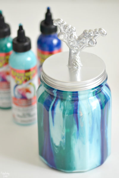 Make this beautiful mermaid jar light using dollar store products and Unicorn Spit! Super fun and easy mermaid craft!