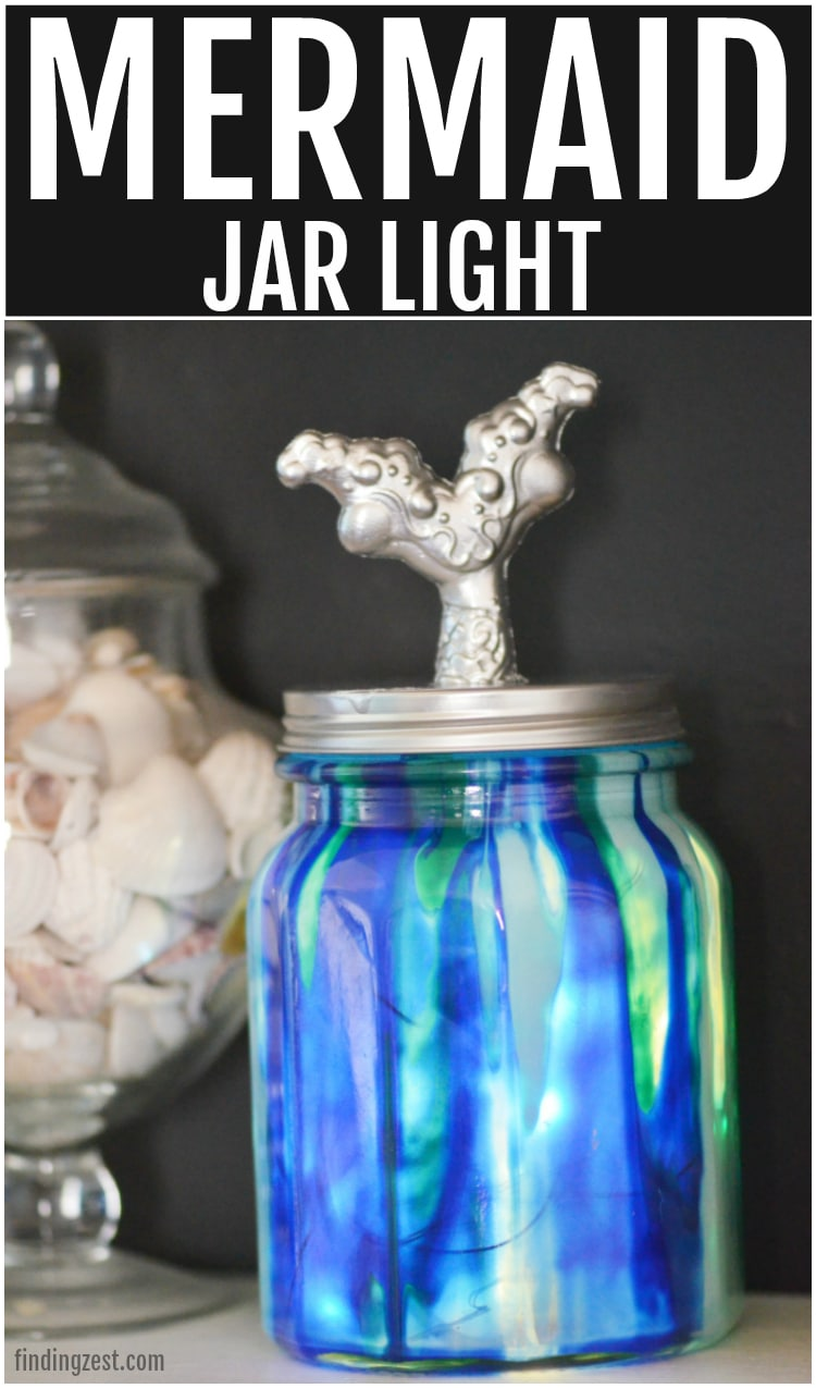 This Mermaid Jar Light craft turns dollar store items into a work of art using Unicorn Spit on glass! Use this as stunning decor for any room or add fairy lights to turn a simple jar into a beautiful light source. Either way, this Unicorn Spit project is a fun DIY idea.