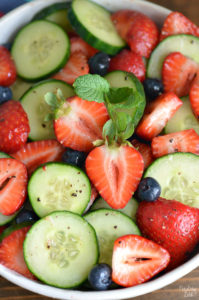 This Strawberry Cucumber Salad is your answer for what to serve with dinner tonight or at your next cookout. Loaded with fresh strawberries, cucumbers and blueberries, this refreshing summer side salad is so easy yet full of flavor!