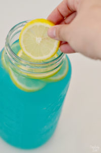 Adding Lemon Slides to Lemonade Punch