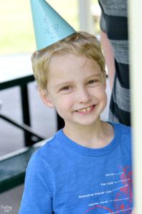 Kid enjoying Mo Willems Pigeon Summer Party