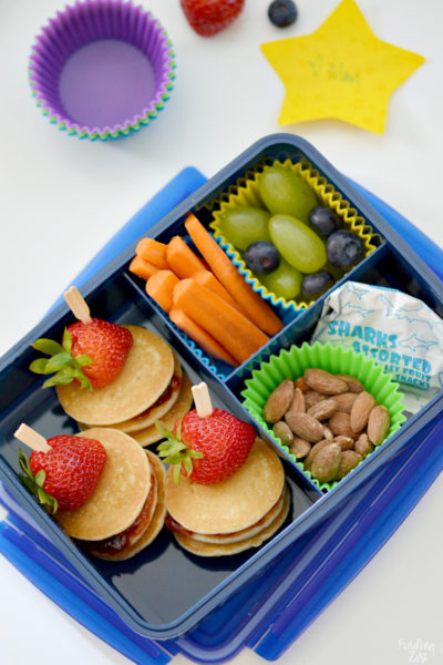 Mini Pancake Stacks in a School Lunchbox with fresh fruit, almonds and fruit snacks