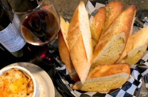 Basket of bread, wine and twice baked potatoes at The Brown Bottle in Waterloo Iowa