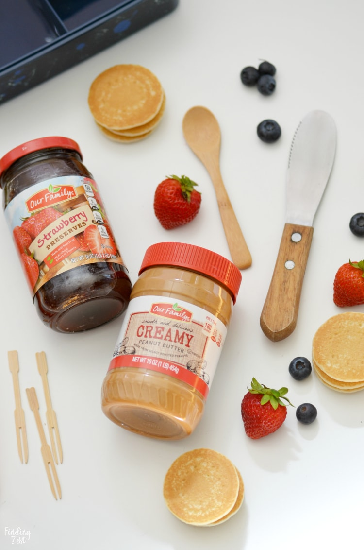 Our family branded peanut butter and jelly with mini pancakes and fresh fruit
