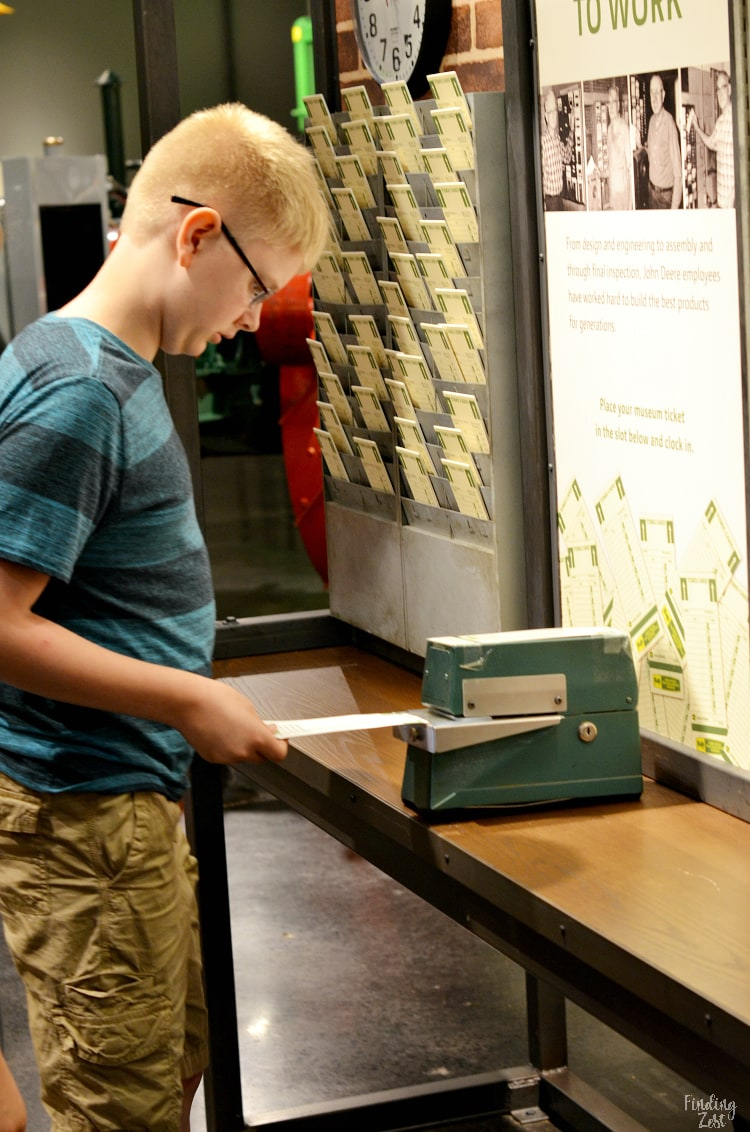 Punching a time card at John Deere Museum in Waterloo Iowa