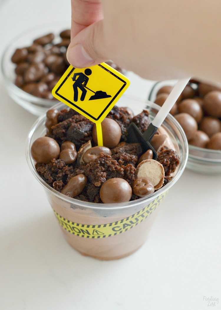 Adding a construction sign pick to dessert cups