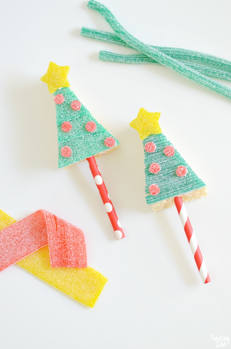 Make your holiday treat table sparkle with these Christmas Tree Rice Krispie Treats featuring Sour Power Candy! This no-bake holiday dessert is a fun activity for all ages. All ingredients can be store-bought so you can focus on decorating these treats on a stick. Perfect for handing out as party favors or classroom gifts.