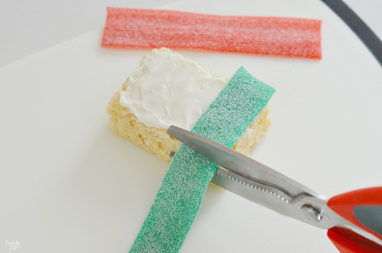 Cutting Sour Power Belt candy to width of Rice Krispie treats