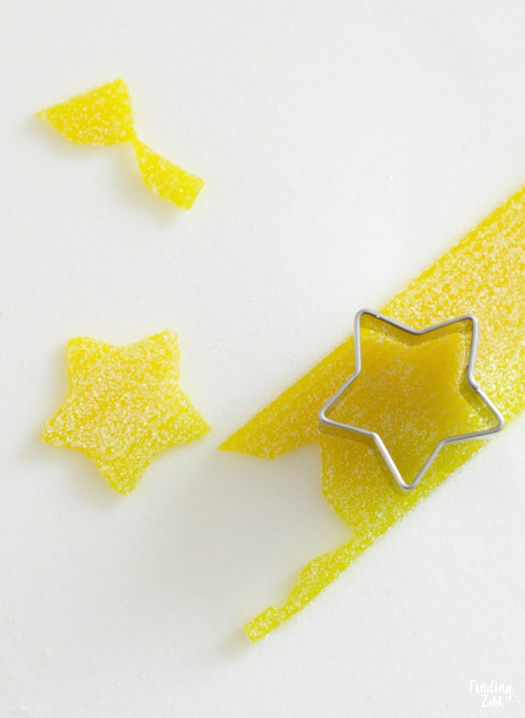 Using wide Sour Power Belt candy to make stars for edible Christmas Tree
