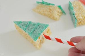 Adding straw to bottom of rice krispies tree