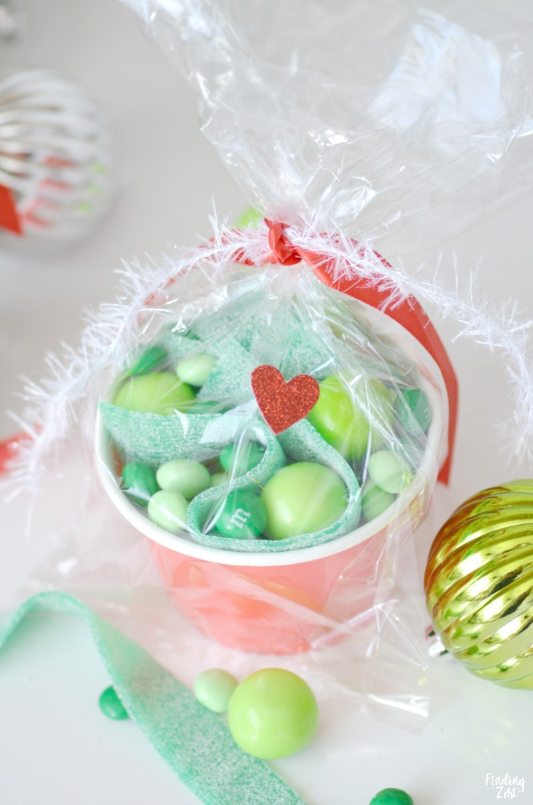 Grinch party favor with red heart sticker and green candy