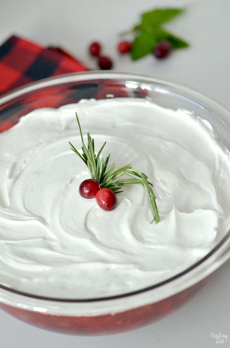 Christmas Jello Salad with Crushed Pineapple, canned cranberries, and topped with whipped topping