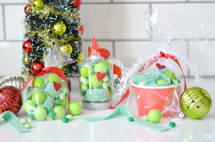 Grinch party favors are the perfect way to spread some holiday cheer this season! Try one of these three Christmas party favor ideas featuring the beloved Christmas character from Dr. Seuss. Using some fun green candy,  you can make Grinch ornaments or go the more traditional route using party bags and cups. Either way, everyone will love to receive one of these three Grinch gifts.
