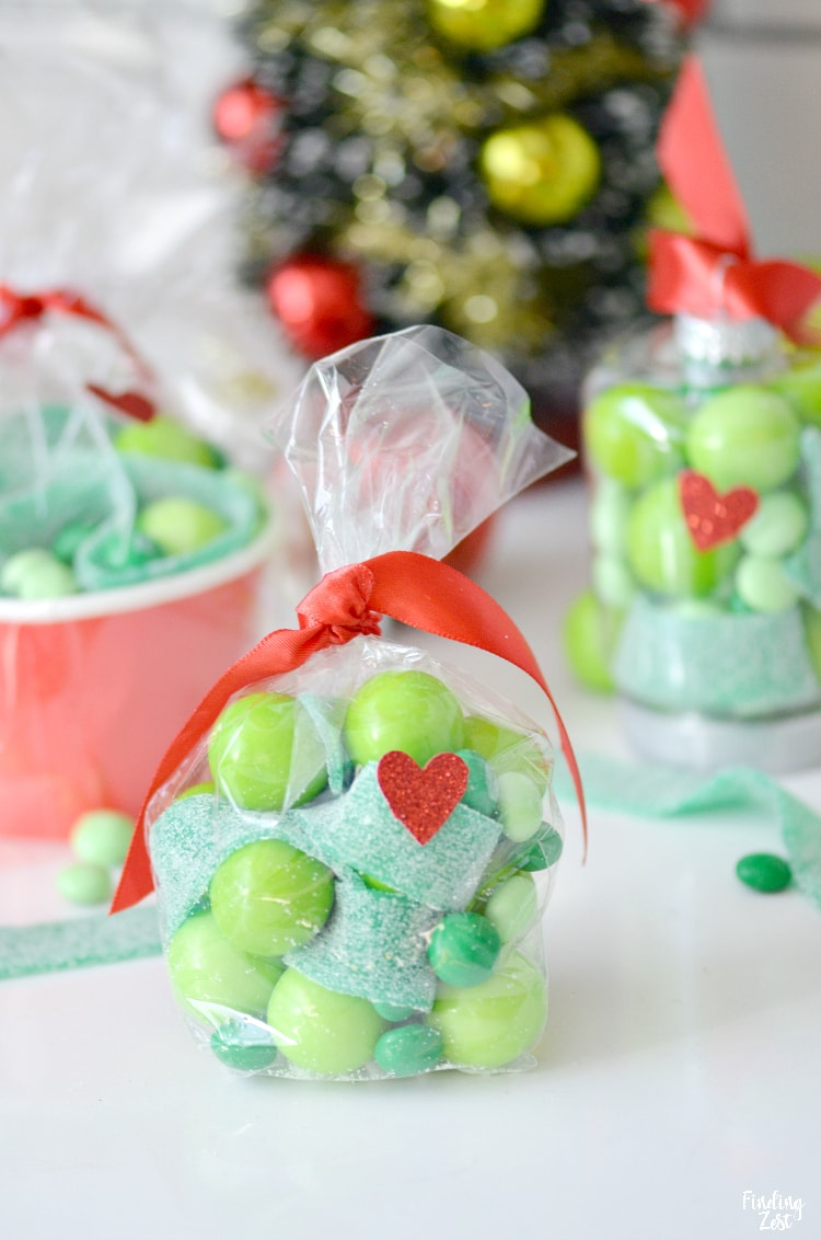 Christmas party favors are made easy with these Grinch gifts! Whether you hand out candy-filled Grinch ornaments or go a more traditional route using party bags and cups, everyone will love to receive one of these three Grinch party favor ideas!