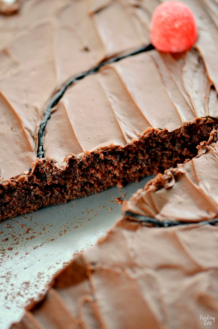 Taking a slice out of a chocolate brownie pizza