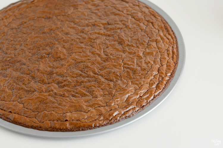 Brownie cooked in a round pizza pan