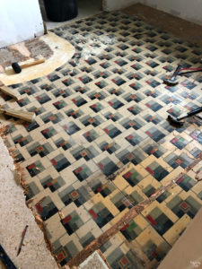 Old linoleum two layers with hardwood underneath
