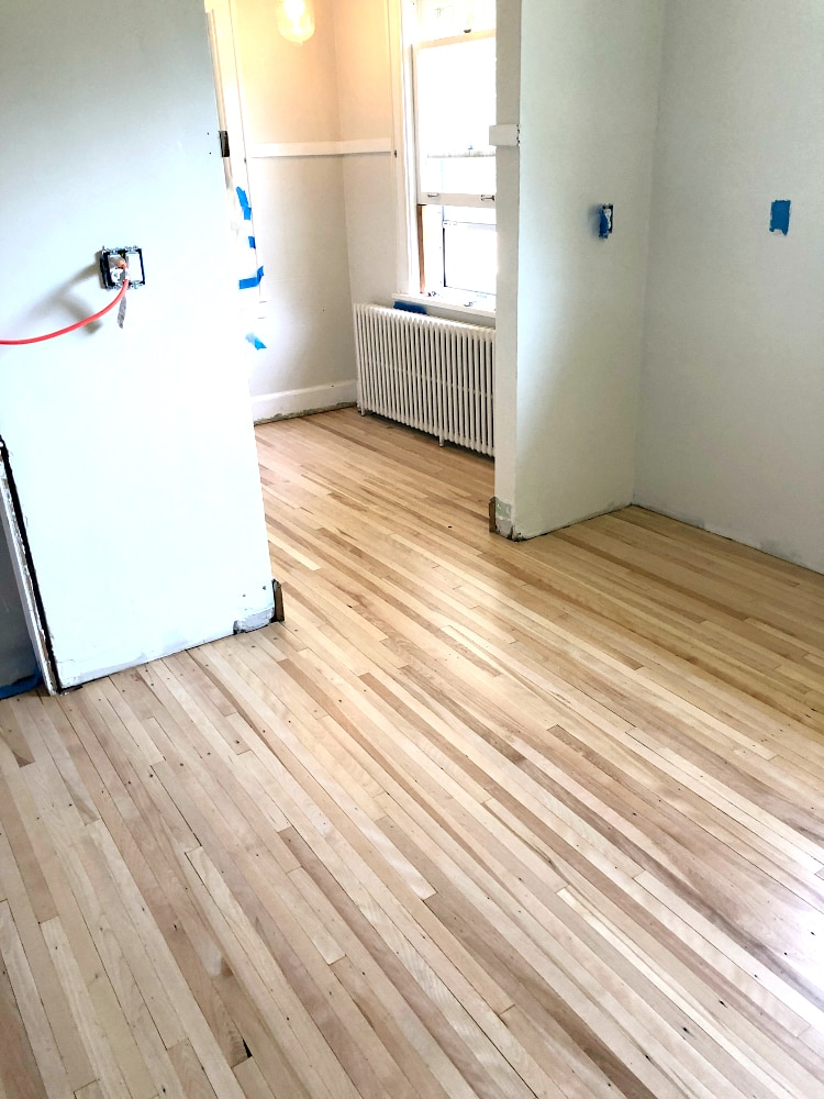 Professionaly refinished maple hardwood floors in kitchen