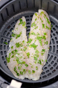 Tilapia in the air fryer produces amazing results! Get that flaky, golden brown fish we all love and still have a healthy meal! This air fryer tilapia with no breading is loaded with flavor and can be on your table in under 15 minutes. Great weeknight dinner recipe!