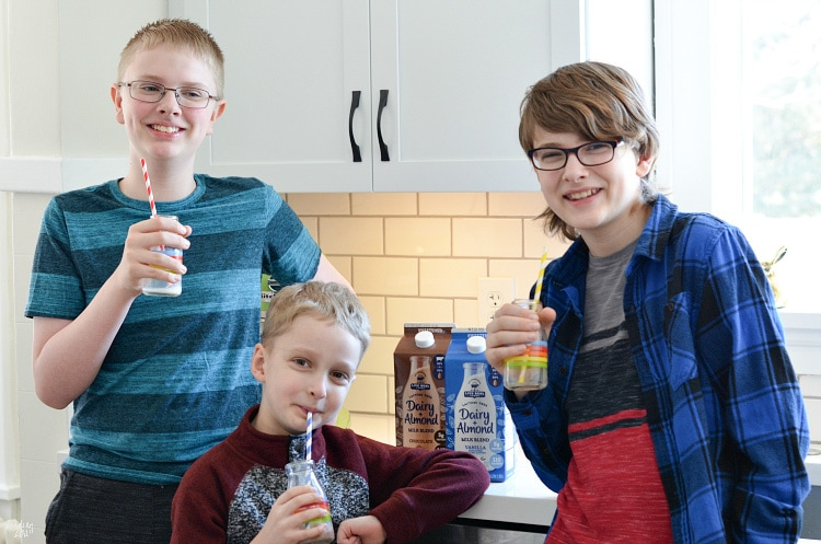 Three kids drinking Live Free Dairy Farms Almond Milk Blend Chocolate