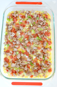 Sausage egg casserole in 13 x 9 inch dish ready to bake