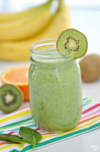 Spinach Banana Smoothie Recipe in glass with kiwi garnish