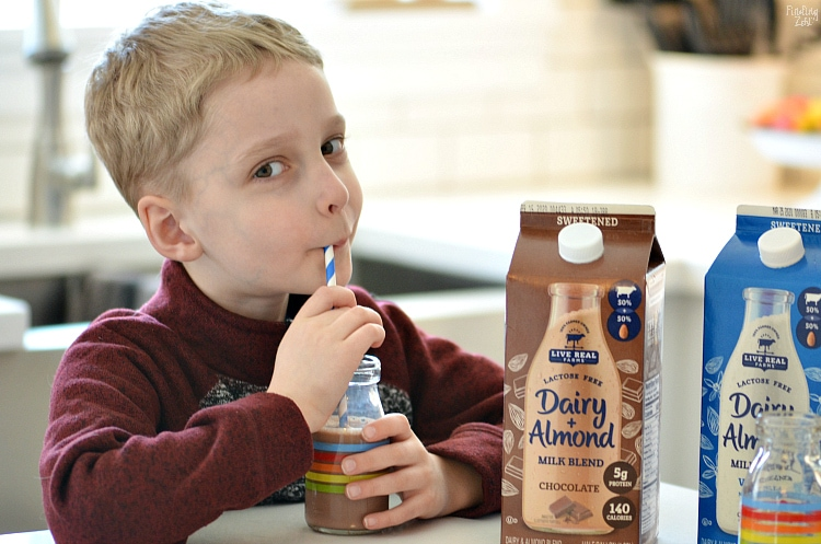 Kid drinking Live Free Dairy Farms Almond Milk Blend Chocolate with a straw
