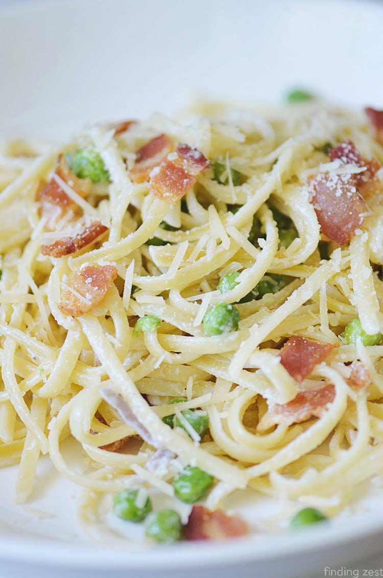 Pasta with peas and bacon is a great dinner recipe! This simple pasta dish is sure to become a favorite!