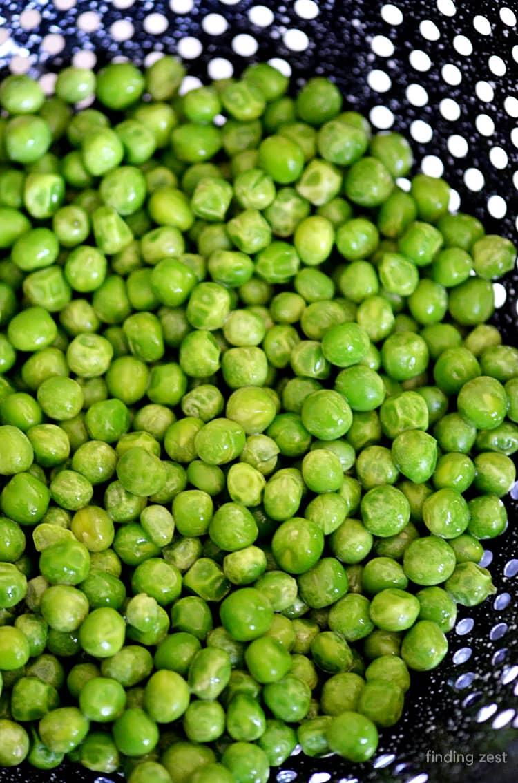 Frozen Peas Thawed in Strainer