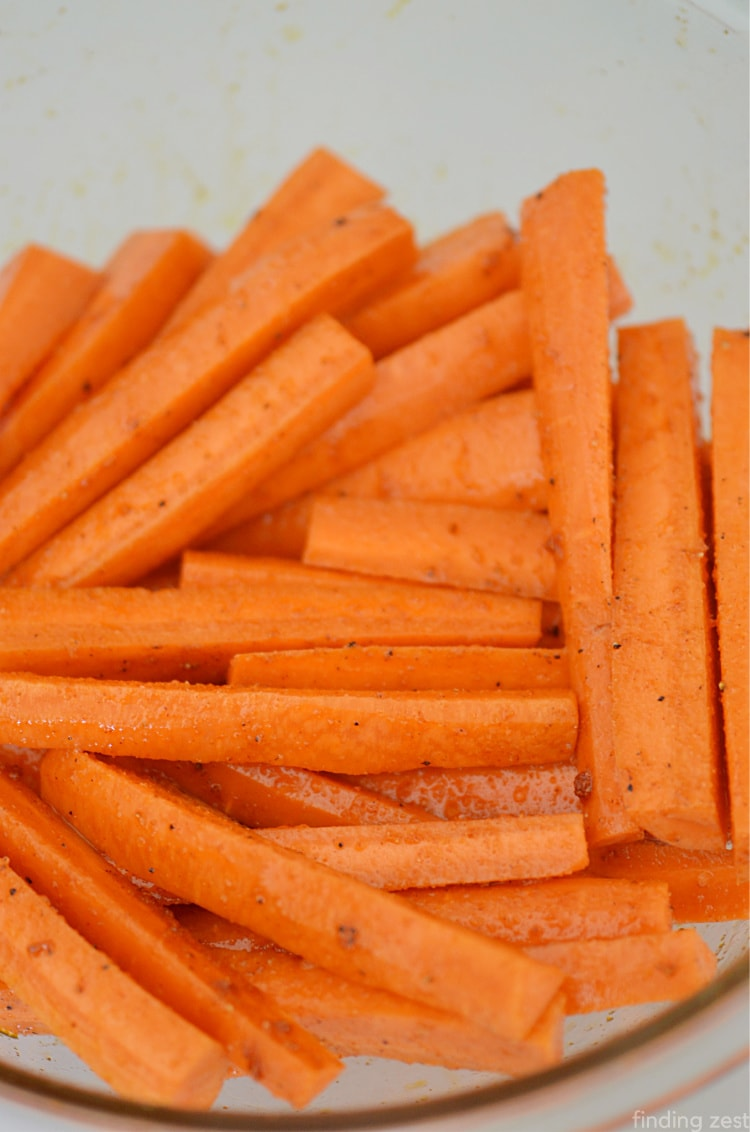 Sliced Carrots in a bowl seasoned with spices