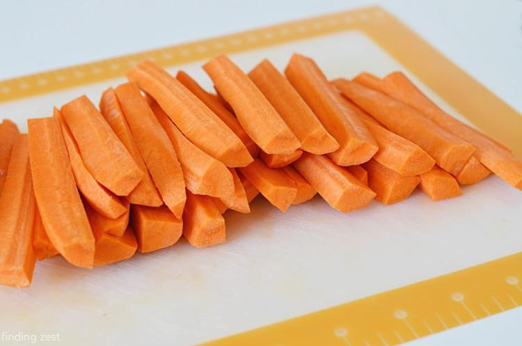 Cut carrot spears for roasting