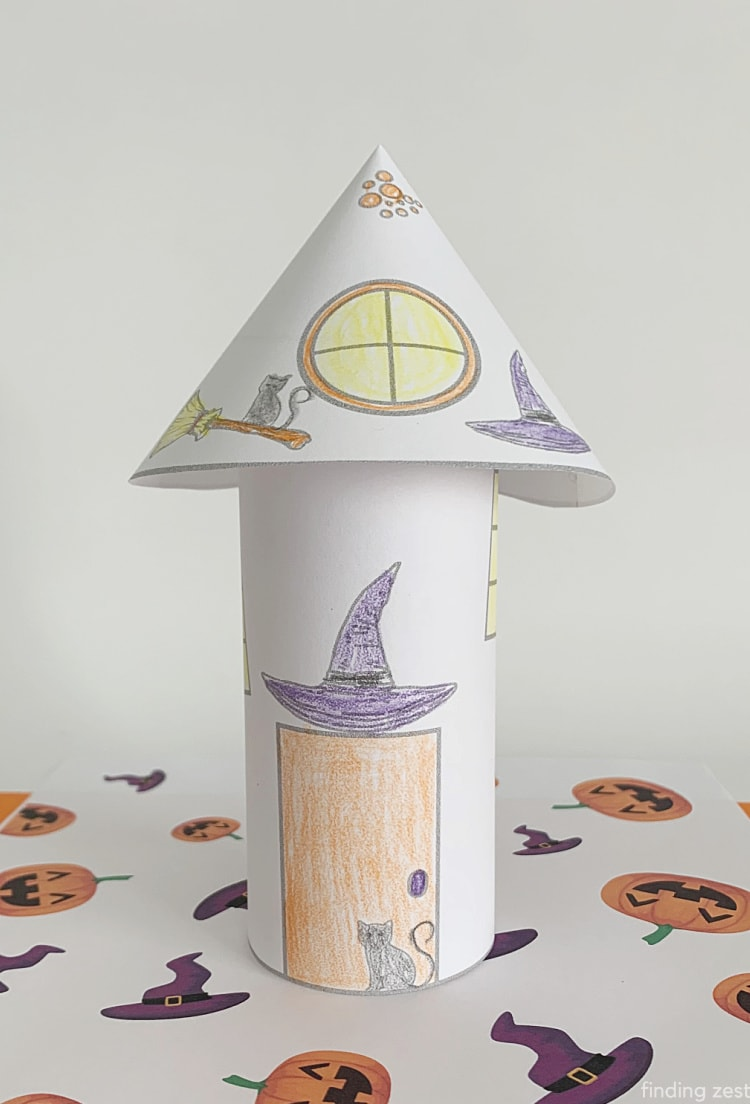 Witch coloring pages come to life with this 3-D haunted house! This free printable is a fun Halloween paper craft that kids can color then cut to turn into their own Halloween decor! Poke holes in the top and add a LED candle to turn this into a luminary!